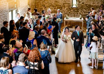 Walking up the aisle at The Tythe Barn