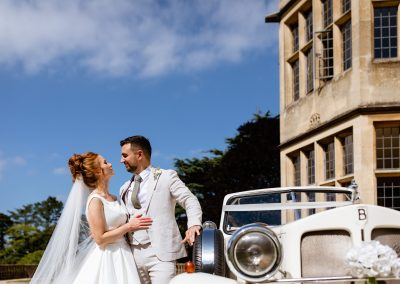 Coombe Lodge wedding, Bride and Groom with the wedding car